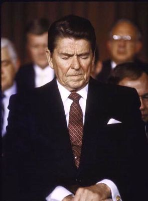 President Ronald Reagan prays. From armystrongstories.com